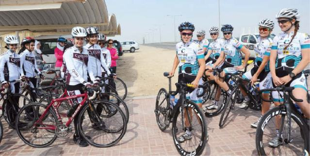 Hosking and her Hitec Products team mates meet with the first ever Qatar women's cycling team.