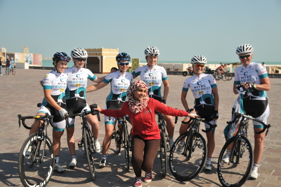 Team Hitec Products at the stage of the third stage of The Ladies Tour of Qatar with a local fan.