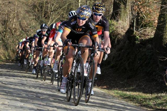 Chloe leads Jolien over the cobbled climb not he large local lap.