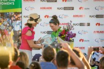 Track sprint star Anna Mears presents Hosking with the Santos Tour Down Under Points Classification trophy. Photo credit Santos Women's Tour / Chameleon Photography